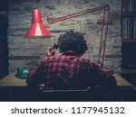 young hipster man working in... | Shutterstock . vector #1177945132