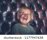 a laughing little toddler with... | Shutterstock . vector #1177947658
