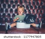 a cheeky little boy is going... | Shutterstock . vector #1177947805