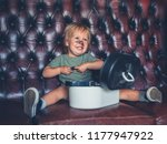 a cheeky little boy is going... | Shutterstock . vector #1177947922