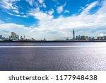 empty asphalt road with city...   Shutterstock . vector #1177948438