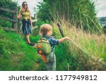 a little toddler is walking in... | Shutterstock . vector #1177949812