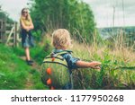 a little toddler is walking in... | Shutterstock . vector #1177950268