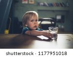 a little toddler boy is sitting ... | Shutterstock . vector #1177951018