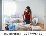 woman ironing clothes on iron... | Shutterstock . vector #1177996432