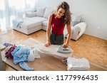 woman ironing clothes on iron... | Shutterstock . vector #1177996435