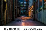 Vancouver, British Columbia - Canada. Empty back alley on one of the streets of Vancouver, British Columbia. Canada. Chilly night just after a rain. Dangerous place to hang around. - stock photo