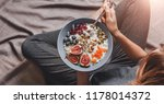 woman in home clothes eating... | Shutterstock . vector #1178014372