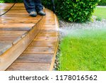 cleaning terrace with a power... | Shutterstock . vector #1178016562