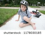 frowning young boy with a cut...   Shutterstock . vector #1178030185
