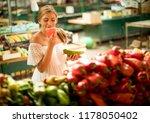 pretty young woman buying fresh ... | Shutterstock . vector #1178050402