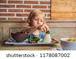 boy eats in a cafe. lifestyle.... | Shutterstock . vector #1178087002
