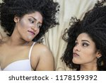 two young afro girls having fun ... | Shutterstock . vector #1178159392