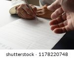 female hand signing contract. | Shutterstock . vector #1178220748