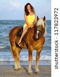 Beautiful Young Woman Riding A...