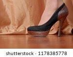 one foot in high heel in front... | Shutterstock . vector #1178385778