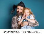 father holding little daughter... | Shutterstock . vector #1178388418
