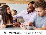 Teacher Helping Elementary...