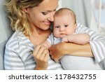 mom holds her 2 month old baby... | Shutterstock . vector #1178432755