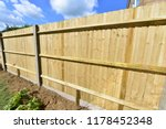 a brand new close boarded fence ... | Shutterstock . vector #1178452348