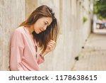 a woman wearing a pink shirt... | Shutterstock . vector #1178638615