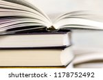 open book on book stack | Shutterstock . vector #1178752492