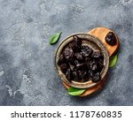 dried prunes on plate. top view ... | Shutterstock . vector #1178760835