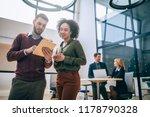 coworkers standing in an office ... | Shutterstock . vector #1178790328