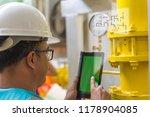 asian engineer wearing glasses... | Shutterstock . vector #1178904085