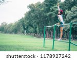 asian woman in grass smiling...   Shutterstock . vector #1178927242