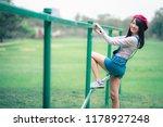 asian woman in grass smiling...   Shutterstock . vector #1178927248