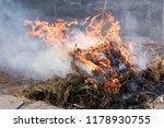 smoldering ashes of a bonfire.... | Shutterstock . vector #1178930755