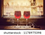 two glasses of red wine.... | Shutterstock . vector #1178975398