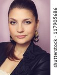 Portrait of confident woman in earrings, close up - stock photo