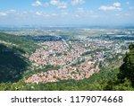 cityscape against mountain... | Shutterstock . vector #1179074668