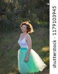 beautiful girl posing on the... | Shutterstock . vector #1179103945