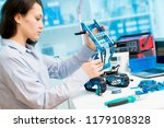 young woman in cnc and robotics ... | Shutterstock . vector #1179108328