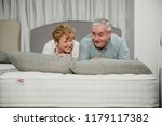 senior couple are lying on a... | Shutterstock . vector #1179117382
