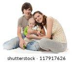 happy family in studio | Shutterstock . vector #117917626