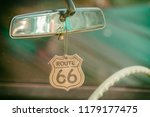 route 66 badge hanging on a car ... | Shutterstock . vector #1179177475