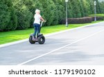 woman with white hair riding... | Shutterstock . vector #1179190102