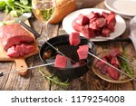 beef fondue and wine | Shutterstock . vector #1179254008