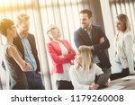 young businesswoman holding a... | Shutterstock . vector #1179260008