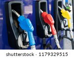 pump nozzles at the gas station | Shutterstock . vector #1179329515