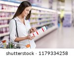 female checking food labeling... | Shutterstock . vector #1179334258