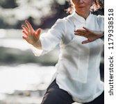 woman practicing tai chi quan...   Shutterstock . vector #1179338518