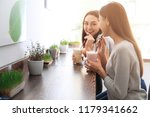 young women with protein shakes ... | Shutterstock . vector #1179341662