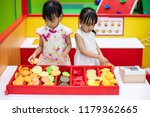 asian chinese little sisters... | Shutterstock . vector #1179362665