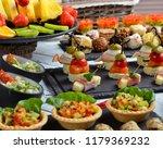 several beautiful sandwiches... | Shutterstock . vector #1179369232