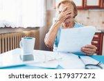 elderly woman looking at her... | Shutterstock . vector #1179377272